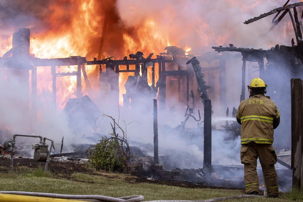 Photo By BENJAMIN KRAIN U201406/20/18u2014 Oak Grove Firefighters Battle A House  Fire At 10100 Short Marche Rd. Near Maumelle Around 6pm Wednesday Evening.