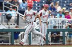 Arkansas first baseman Jared Gates (3) is congratulated by hitting coach Nate Thompson (30) after Gates hit a home run during a College World Series game against Texas Tech on Wednesday, June 20, 2018, in Omaha, Neb.