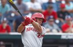 Arkansas outfielder Dominic Fletcher hits a home run during the fourth inning of a College World Series game against Texas Tech on Wednesday, June 20, 2018, in Omaha, Neb.