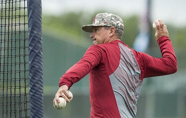 Arkansas coach Dave Van Horn throws batting practice on Thursday, June 21, 2018, at Creighton University in Omaha, Neb.
