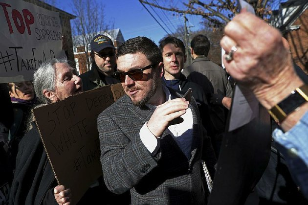 jason-kessler-pushes-through-a-crowd-of-protesters-at-the-charlottesville-va-courthouse-for-a-hearing-in-february-kesslers-application-for-a-permit-to-hold-a-white-civil-rights-rally-near-the-white-house-has-been-preliminarily-approved-by-the-national-park-service