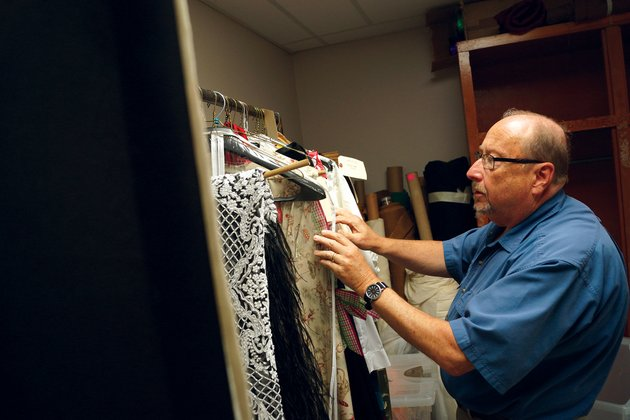 steve-frye-producer-of-the-searcy-summer-dinner-theatre-and-chairman-of-the-harding-university-theatre-department-looks-through-the-costumes-for-the-upcoming-production-of-moon-over-buffalo-it-is-set-for-730-pm-thursday-through-july-1-and-july-5-7-in-the-ulrey-performing-arts-center-on-campus-tickets-at-32-each-or-17-for-the-show-only-are-available-at-hardingticketscom-or-by-calling-501-279-4276