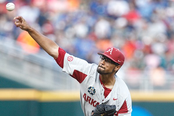 Arkansas pitcher Isaiah Campbell throws during a College World Series game against Florida on Friday, June 22, 2018, in Omaha, Neb.