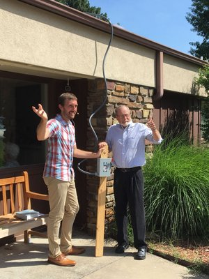 Courtesy Photo Pastor Clint Schnekloth (left) and Fayetteville Mayor Lioneld Jordan celebrate the fact that Good Shepherd Lutheran Church in Fayetteville has been banking energy since its solar array went online in May.