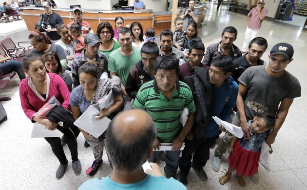 immigrants-listen-to-instructions-from-a-volunteer-inside-the-bus-station-after-they-were-processed-and-released-by-us-customs-and-border-protection-friday-june-22-2018-in-mcallen-texas-ap-photodavid-j-phillip
