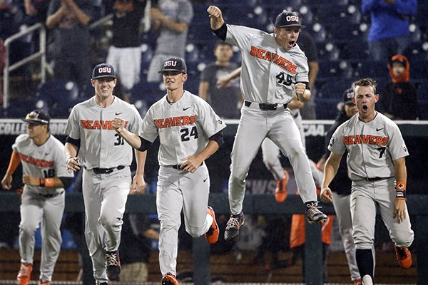 Oregon State players celebrate after the final out against North Carolina in an NCAA College World Series baseball elimination game in Omaha, Neb., Wednesday, June 20, 2018. Oregon State won 11-6. (AP Photo/Nati Harnik)