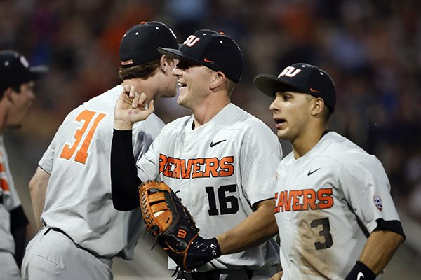 oregon-state-first-baseman-zak-taylor-16-smiles-after-a-double-play-against-mississippi-state-ended-the-sixth-inning-of-an-ncaa-college-world-series-baseball-elimination-game-in-omaha-neb-saturday-june-23-2018-ap-photonati-harnik