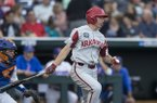 Arkansas shortstop Jax Biggers bats during a College World Series game against Florida on Friday, June 22, 2018, in Omaha, Neb.