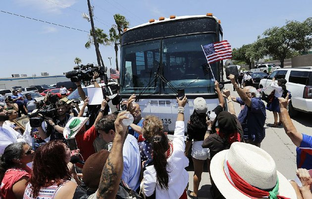 demonstrators-shouting-shame-shame-at-border-patrol-agents-attempt-to-block-a-bus-carrying-detainees-saturday-outside-a-us-border-patrol-processing-center-in-mcallen-texas