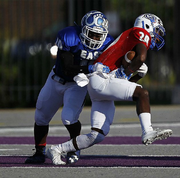 west-defensive-back-dillon-scott-20-of-arkadelphia-intercepts-a-pass-during-the-second-quarter-of-the-wests-52-21-victory-in-the-arkansas-high-school-coaches-association-all-star-football-game-saturday-at-estes-stadium-in-conway-scott-intercepted-three-passes-and-returned-a-punt-for-a-touchdown-to-earn-most-valuable-player-honors-see-more-photos-at-arkansasonlinecomgalleries