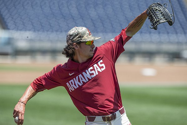 Arkansas pitcher Blaine Knight throws during practice Sunday, June 24, 2018, in Omaha, Neb.