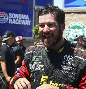 Martin Truex Jr. smiles after winning a NASCAR Sprint Cup Series auto race Sunday, June 24, 2018, in Sonoma, Calif.