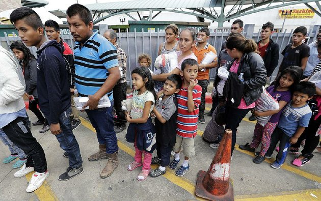 immigrant-families-line-up-to-enter-the-central-bus-station-after-they-were-processed-and-released-by-us-customs-and-border-protection-on-sunday-in-mcallen-texas
