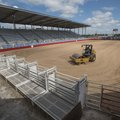 Jimmy Bowen compresses the sand and dirt on the arena floor of Parsons Stadium to get the stadium re...