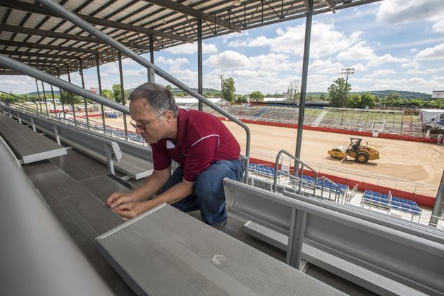thomas-pittman-replaces-the-stadium-seating-numbers-at-parsons-stadium-to-get-the-stadium-ready-for-the-74th-rodeo-of-the-ozarks-the-rodeo-is-wednesday-through-saturday-the-rodeo-still-has-openings-for-youth-ages-4-12-to-participate-in-the-pre-rodeo-activities-of-mutton-bustin-goat-scramble-and-calf-scramble-and-online-registration-is-available-at-rodeooftheozarksorg-this-year-they-also-offer-the-ability-to-purchase-tickets-online-and-print-them-at-home