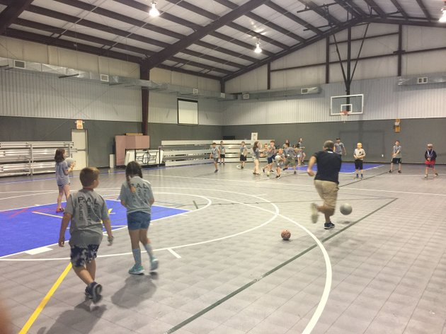 nwa-democrat-gazettetracy-m-neal-participants-in-the-benton-county-sheriffs-offices-pal-programs-junior-police-academy-play-dodge-ball-friday-with-deputies-and-volunteers-the-children-spent-the-five-days-of-the-academy-learning-about-law-enforcement-and-their-job