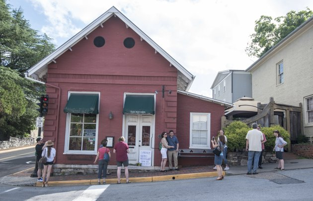 passersby-gather-to-take-photos-in-front-of-the-red-hen-restaurant-saturday-june-23-2018-in-lexington-va-white-house-press-secretary-sarah-huckabee-sanders-said-saturday-in-a-tweet-that-she-was-booted-from-the-virginia-restaurant-because-she-works-for-president-donald-trump-sanders-said-she-was-told-by-the-owner-of-the-red-hen-that-she-had-to-leave-because-i-work-for-potus-and-i-politely-left-ap-photodaniel-lin