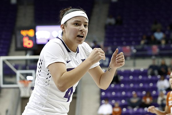 TCU guard Amber Ramirez (4) celebrates a basket against Texas in the first half of an NCAA college basketball game, Wednesday, Jan. 10, 2018, in Fort Worth, Texas. (AP Photo/Tony Gutierrez)