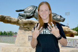 Graham Thomas/Herald-Leader Siloam Springs alum and assistant soccer and cross country coach Abby Ray has won 11 state championships in five years of coaching at her alma mater. Ray, seen here with 10 state championship rings — four in girls cross country, four in girls soccer and two in boys soccer — will receive No. 11 and the fifth for girls soccer this fall.
