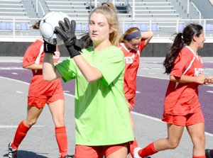 Graham Thomas/Herald-Leader Siloam Springs' Sydney Bomstad catches a ball as she comes off the field after pre-game introductions before the Arkansas High School Coaches Association All-Star Girls Soccer Match last Friday at Estes Stadium in Conway.