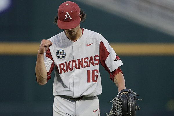 Arkansas pitcher Blaine Knight (16) pumps his fist as he walks off the mound after the sixth inning of Game 1 of the NCAA College World Series baseball finals between Oregon State and Arkansas in Omaha, Neb., Tuesday, June 26, 2018. (AP Photo/Nati Harnik)