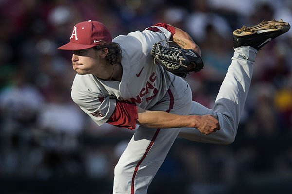 Arkansas pitcher Blaine Knight throws the ball during a College World Series finals game against Oregon State on Tuesday, June 26, 2018, in Omaha, Neb.