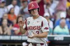 Arkansas first baseman Jared Gates claps his hands as he scores a run during the fifth inning of a College World Series finals game against Oregon State on Tuesday, June 26, 2018, in Omaha, Neb.