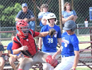 Rick Peck/Special to McDonald County Press McDonald County catcher Joe Brown reaches in an attempt to tag a Seneca runner in the McDonald County 18U baseball team's 14-2 win over Seneca on June 19 in Seneca.