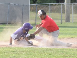 Rick Peck/Special to McDonald County Press McDonald County shortstop Wyatt Jordan throws to first after fielding a ground ball during McDonald County's 9-3 loss on June 21 in Monett.