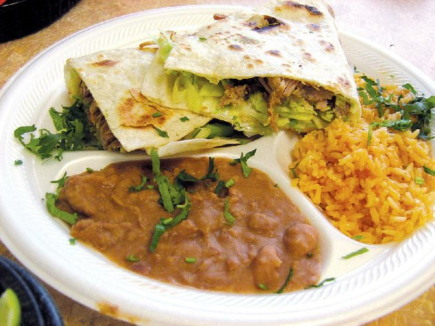taqueria-el-primo-in-sherwood-serves-quesadillas-filled-with-ones-choice-of-meat-lettuce-cheese-tomato-and-avocado-here-its-made-with-carnitas-along-with-rice-and-beans