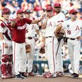 Arkansas Coach Dave Van Horn tries to get an umpire's attention for a pitching change in the third i...