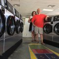 Tiffany and Ben Snodgrass stand in the middle of Sugar Creek Laundry, one of two laundromats they ow...