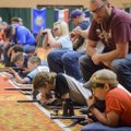 Young competitors finish the prone position shooting event during the 2018 annual Daisy National BB ...