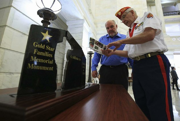 paul-garrett-right-co-chairman-of-a-committee-hoping-to-build-a-monument-to-honor-gold-star-families-talks-tuesday-with-greg-williams-chief-executive-officer-of-nabholz-construction-company-in-conway-at-the-state-capitol