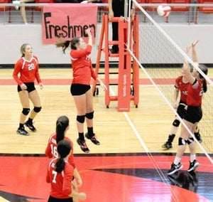 MARK HUMPHREY ENTERPRISE-LEADER Farmington 2018 graduate Ella Wilson, a middle blocker/hitter, plays the ball over the net against Clarksville. The Lady Cardinals swept the visitors 3-0 Tuesday, Oct. 3, 2017. A day earlier Wilson became the All-time leader in block-kills when she recorded 3 in a match against Huntsville.