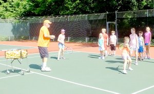 Lynn Atkins/The Weekly Vista Tennis Pro Jake Shoemake runs drills with junior tennis players on the Kingsdale Tennis courts last week. Another session of group lessons and two sessions of tennis camp are planned for this summer.