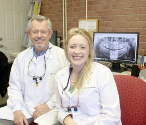 LYNN KUTTER ENTERPRISE-LEADER Dr. Catherine Akridge is a new dentist with Dr. John Bain in Farmington. She is a graduate of the University of Arkansas and a recent graduate of the School of Dentistry at Louisiana State University.