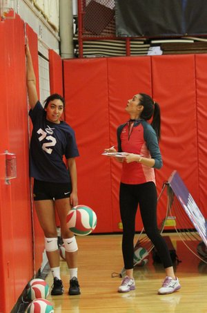 PHOTO COURTESY USA VOLLEYBALL Lizzy Briones, a coordinator of the USA Volleyball High Performance program, (at right) takes measurements of one of the athletes participating in one of their many camps across the country.