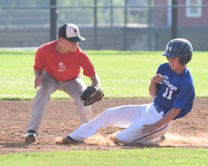 Rick Peck/Special to McDonald County Press McDonald County second baseman Josh Parsons tags out a Carthage runner attempting to steal second base in McDonald County's 9-4 win on June 27 at MCHS.