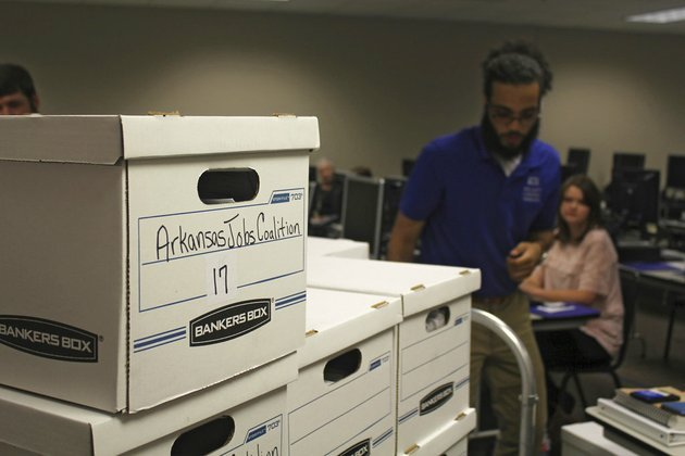 boxes-containing-petitions-in-favor-of-a-proposal-to-legalize-casinos-in-arkansas-are-delivered-to-the-arkansas-secretary-of-states-office-friday-july-6-2018-in-little-rock