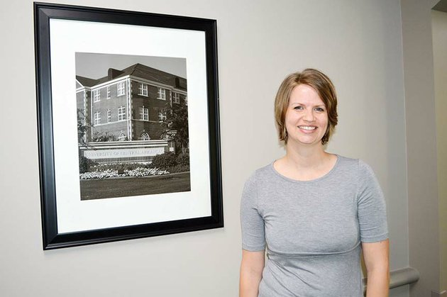 lesley-graybeal-of-conway-stands-near-a-photo-of-the-university-of-central-arkansas-that-hangs-in-the-hallway-of-brewer-hegemann-conference-center-on-campus-graybeal-was-named-nonclassified-employee-of-the-year-for-the-past-academic-year-she-is-director-of-the-service-learning-program-at-uca-and-has-partnerships-with-more-than-100-agencies-in-central-arkansas-to-provide-volunteer-opportunities-for-students-through-course-based-projects