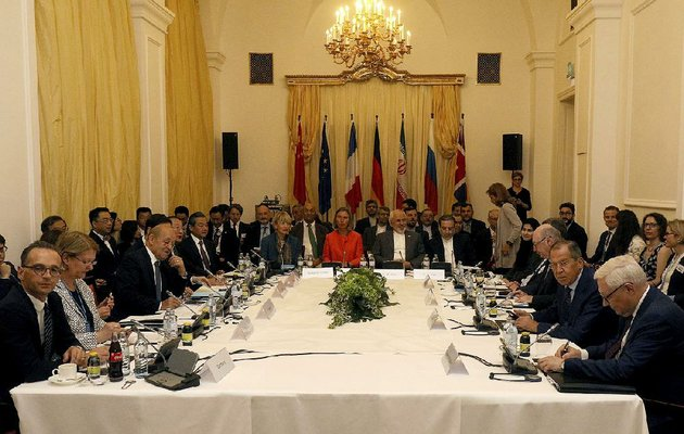 delegates-sit-around-a-table-prior-to-a-bilateral-meeting-as-part-of-the-closed-door-nuclear-talks-with-iran-at-a-hotel-in-vienna-austria