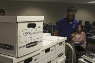 Boxes containing petitions in favor of a proposal to legalize casinos in Arkansas are delivered to the Arkansas secretary of state's office on Friday, July 6, 2018 in Little Rock, Ark. Friday was the deadline for ballot measure groups to submit signatures to try and get their proposals on the November ballot. (AP Photo/Andrew Demillo)