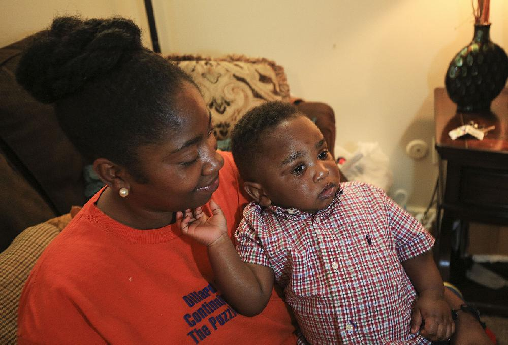 Lakinda Williams Holds Her 1 Year Old Son Aiden In The