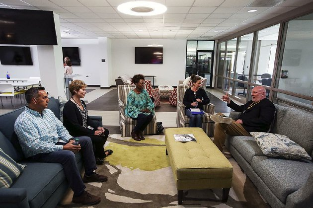 acxiom-president-and-ceo-scott-howe-right-talks-with-employees-last-year-at-company-offices-in-conway-acxiom-last-week-reached-a-deal-to-sell-the-bulk-of-the-company-to-global-advertising-holding-company-interpublic-group