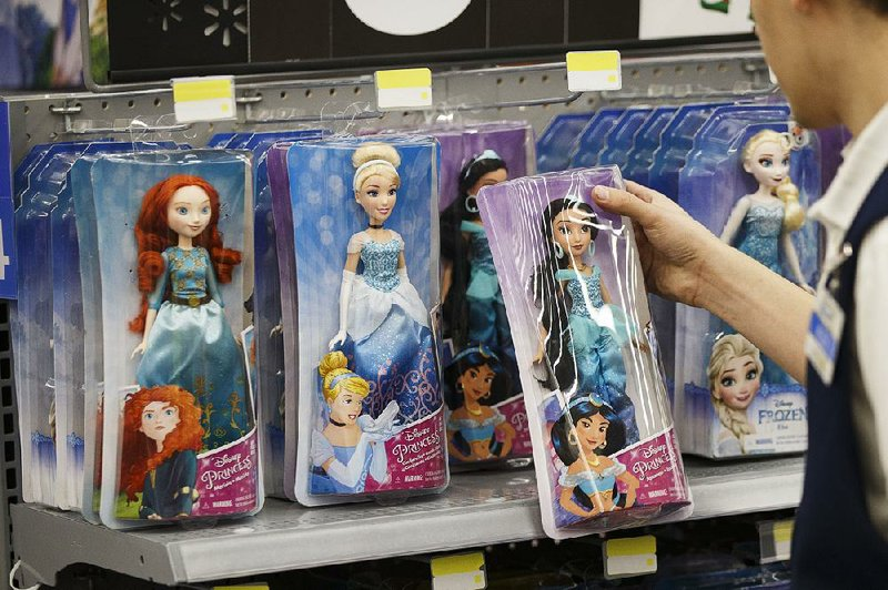 an employee restocks disney branded toys at a walmart store in burbank calif in late 2016