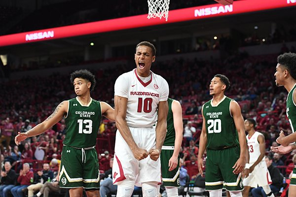Arkansas forward Daniel Gafford celebrates a shot and foul during a game against Colorado State on Tuesday, Dec. 5, 2017, in Fayetteville.