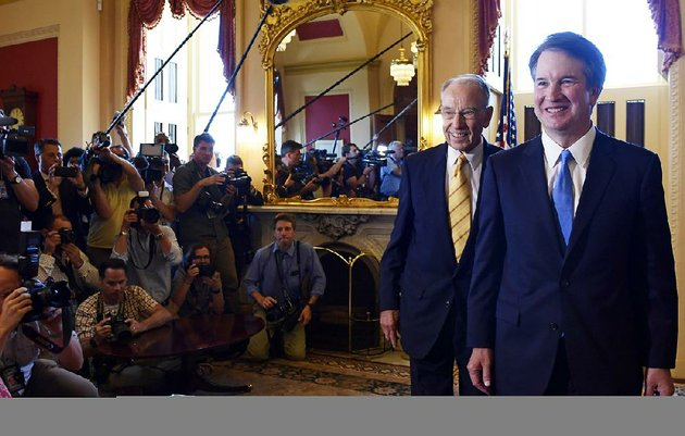 supreme-court-nominee-brett-kavanaugh-right-is-escorted-by-sen-charles-grassley-r-iowa-during-a-visit-with-republican-leaders-tuesday-on-capitol-hill