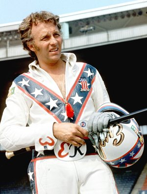 FILE PHOTO - In this Aug. 20, 1974, file photo, Evel Knievel poses at the Canadian national exhibition stadium in Toronto. Fifty years after Evel Knievel so famously wiped out trying to jump the fountain at Caesar's Palace, action sports wild man Travis Pastrana naiedl the stunt Sunday night, July 8, 2018, in the finale of a triple-header tribute to the late daredevil. (AP Photo/File)