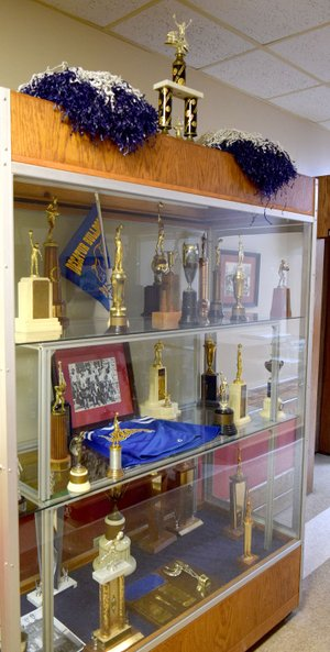 Westside Eagle Observer/MIKE ECKELS The new display case at Decatur City Hall contains trophies, plaques, a cheerleader's outfit, and other sports memorabilia from the 1939-1999 Decatur High School basketball, football and cheerleading programs.